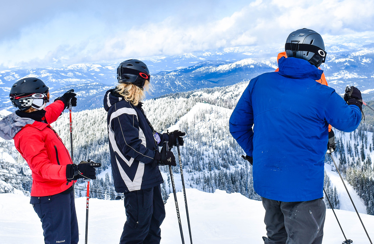 Skiers looking across the valley